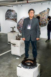Artist Dan Raralio with Isuzu artworks.